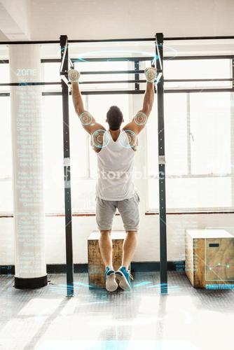 Composite image of rear view of man doing pull ups