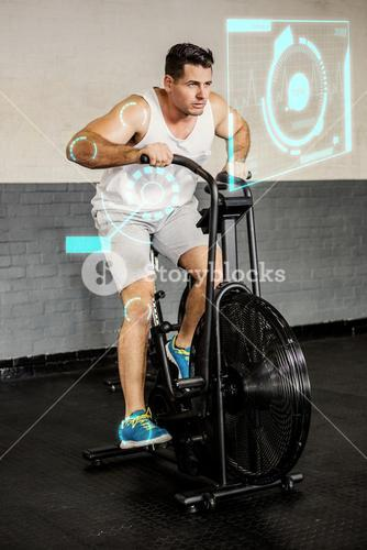 Composite image of man riding exercise bike