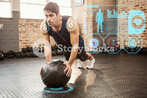 Composite image of man doing push ups on medicine ball