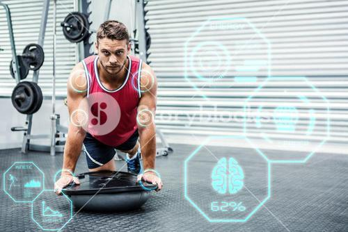 Composite image of portrait of muscular man using bosu ball