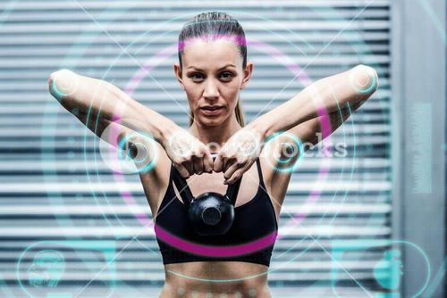 Composite image of a muscular woman lifting kettlebells