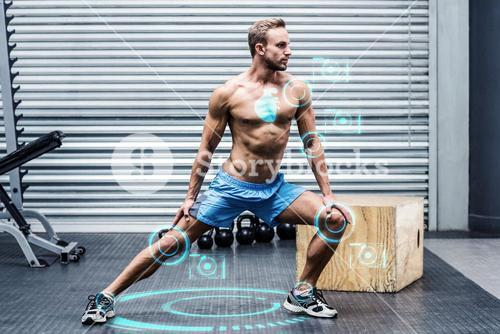 Composite image of muscular man doing leg stretchings