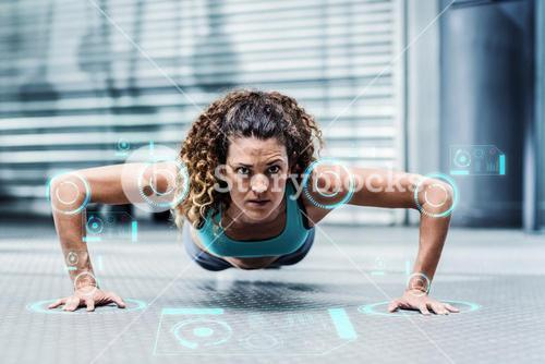 Composite image of attentive muscular woman doing pushups