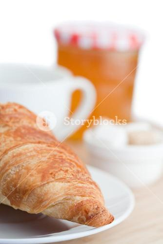 Breakfast with coffee a croissant and marmalade