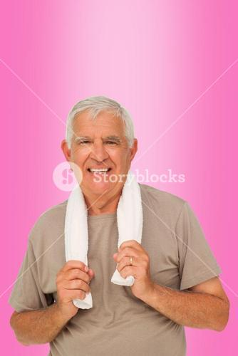 Composite image of portrait of a senior man with towel