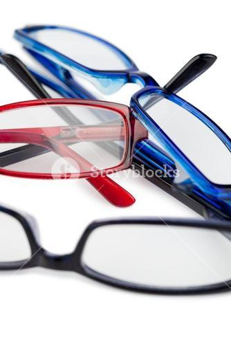 Three pairs of glasses with blue black and red frames