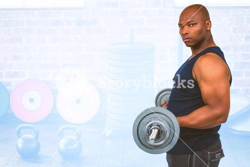 Composite image of fit man lifting heavy barbell