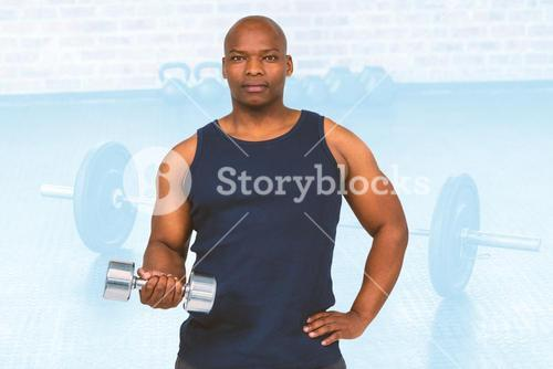 Composite image of muscular man exercising with dumbbell