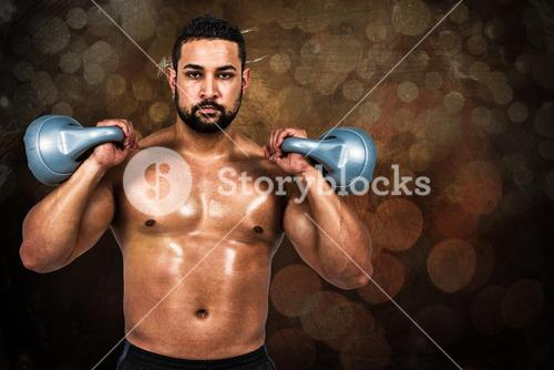 Composite image of muscular man lifting heavy kettlebell