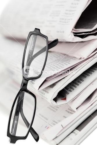 Newspapers and reading glasses