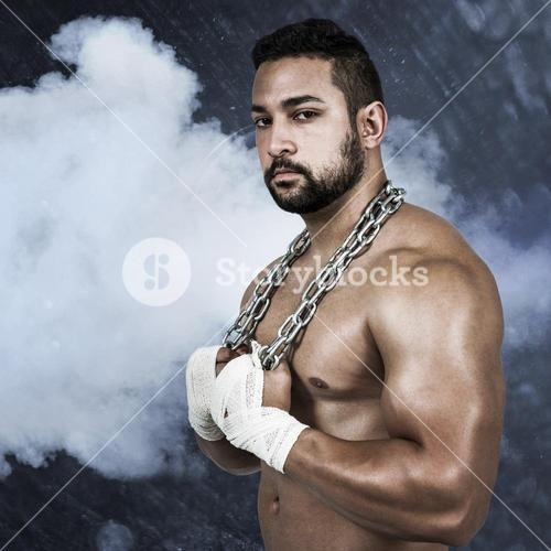 Composite image of muscular man with a chain