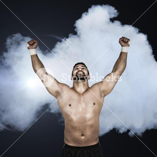 Composite image of muscular man cheering