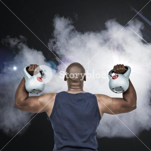 Composite image of muscular man exercising with kettlebell