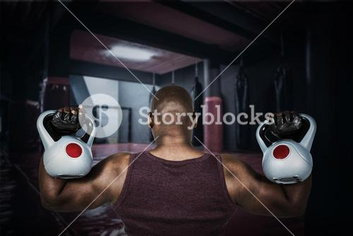 Composite image of fit man exercising with kettlebell