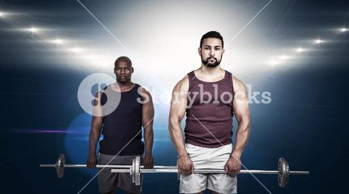 Composite image of man lifting barbell with trainer
