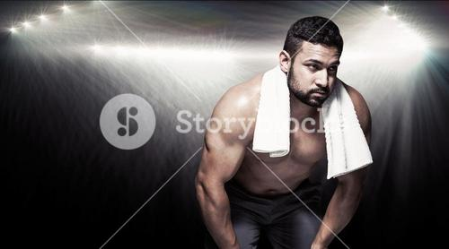 Composite image of bodybuilder man with hands on thighs