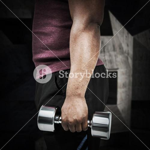Composite image of fit man exercising with dumbbell