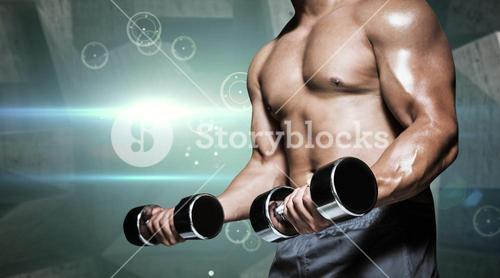 Composite image of mid section of a bodybuilder with dumbbells