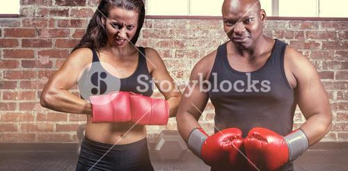 Composite image of portrait of male and female boxers with gloves