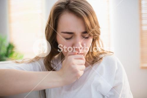 Pretty woman coughing