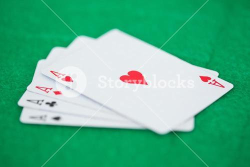 Card game aces on a green background