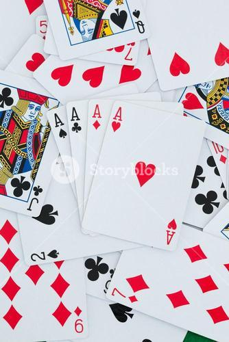 Playing cards background with four aces