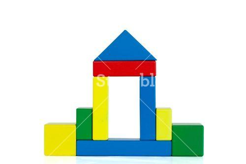 House built out of wooden toy blocks
