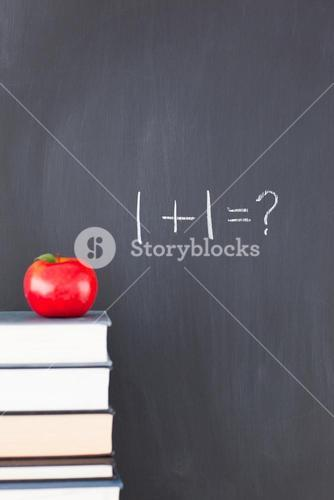 Books with an apple and a blackboard with