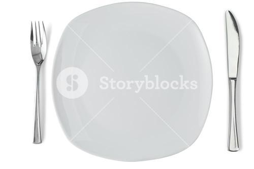 White plate with silver knife and fork