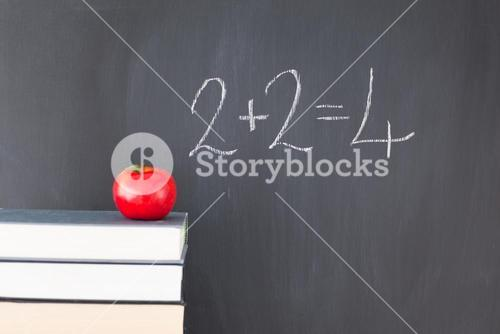 Books with an apple and a blackboard