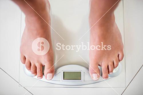 Feet of woman on weighting scale