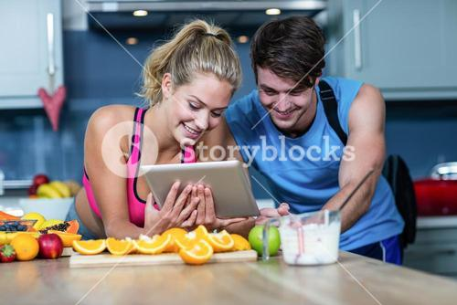 Healthy couple looking at tablet