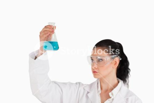 Darkhaired scientist conducting an experiment