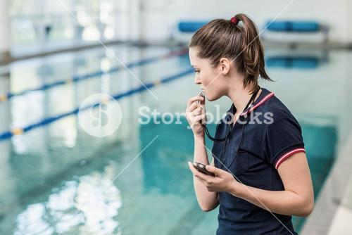 Fit woman blowing whistle