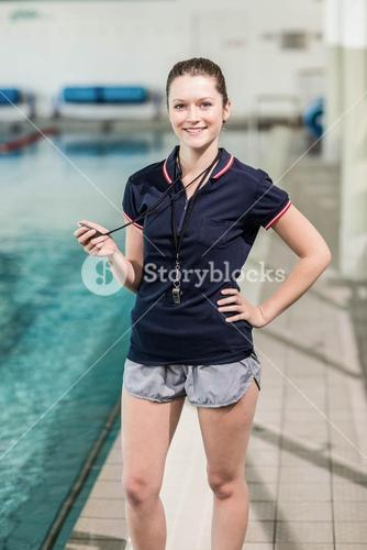 Pretty trainer holding a stopwatch