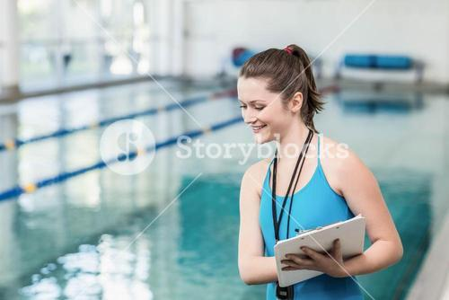 Pretty trainer taking notes