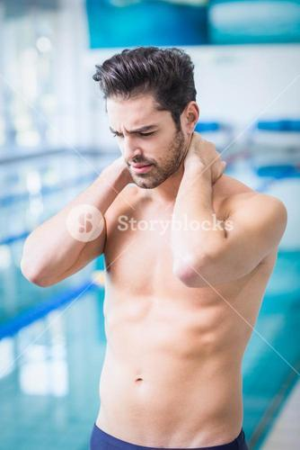 Handsome man having neck pain