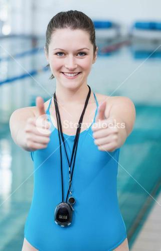 Pretty trainer with thumbs up
