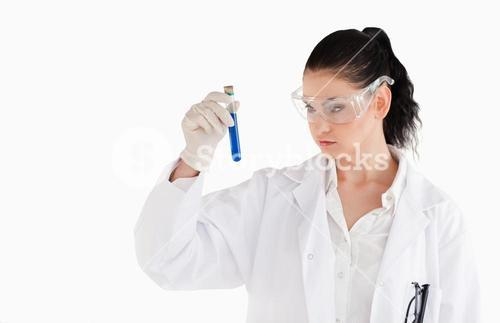 Darkhaired woman carrying out an experiment