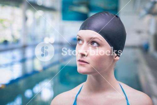 Pretty woman wearing swim cap