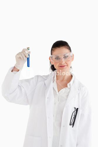 Darkhaired scientist looking at the camera