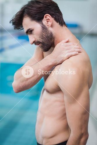 Handsome man with shoulder pain