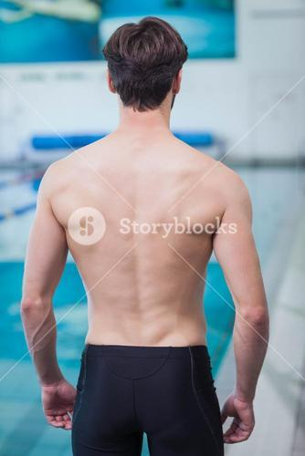 Rear view of shirtless man