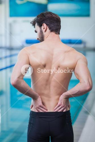 Fit man having back pain