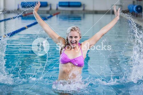 Pretty woman doing aqua aerobics