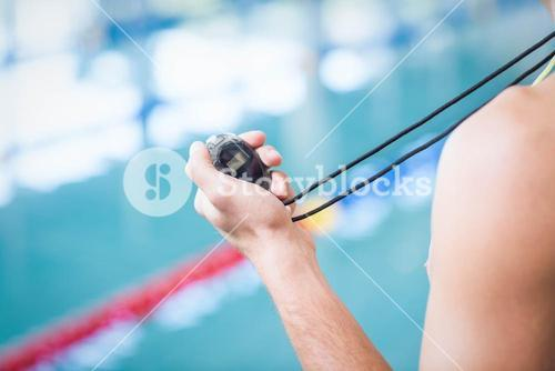 Trainer holding stopwatch