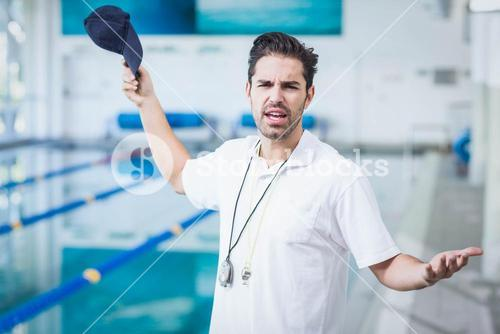 Serious trainer angry at someone
