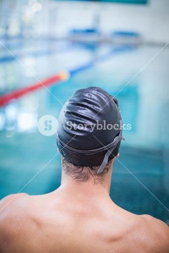 Handsome man wearing swim cap and goggles