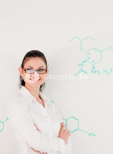 Darkhaired scientist woman looking at the camera