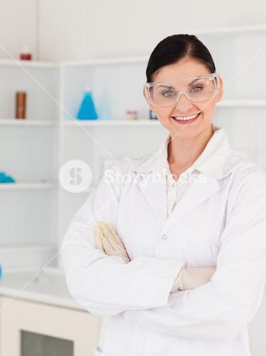Darkhaired woman with safety glasses